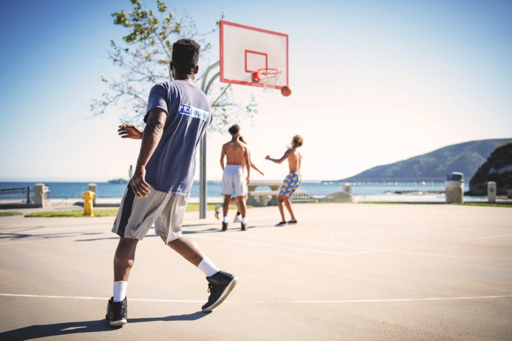 basketball players on an outdoors court