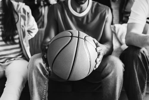 A man holding a basketball